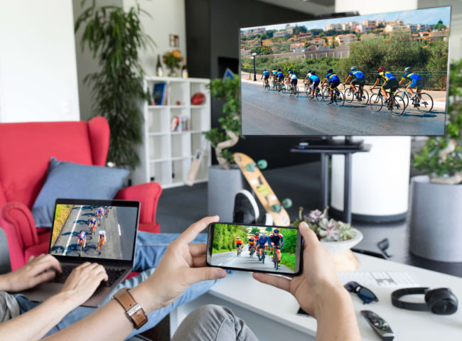 Solutions > Synced Multiscreen Experience - synced devices showing a cycle race