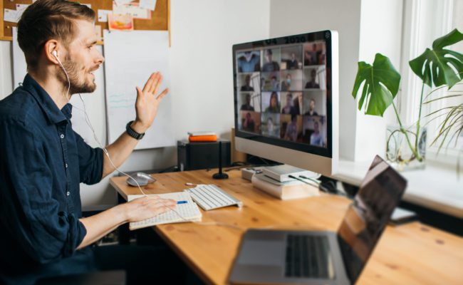 Attending conferences remotely - A man having video conference via computer