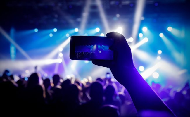 Solutions > On-site Experience - mobile device filming at a live concert