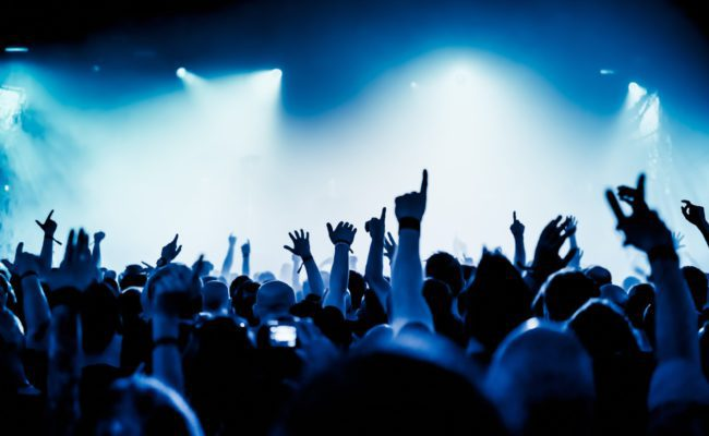 Applications > Live Concerts - image of a cheering crowd