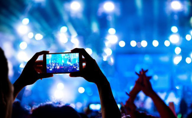 On-site - Person holding a smartphone at live concert